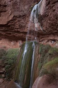 Hikers Looking at Ribbon Falls in the Grand Canyon by Stephen Alvarez