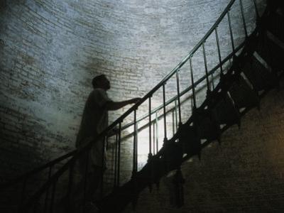 Man Climbs the Staircase Inside the Currituck Beach Lighthouse