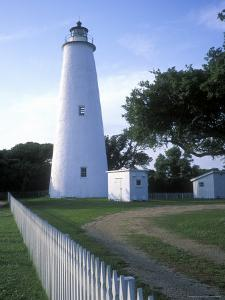 The Lighthouse Stands Behind a Fence on Ocracoke Island by Stephen Alvarez