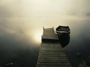 The Morning Sun Shines on a Rowboat Tied to a Dock by Stephen Alvarez
