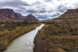 The Rain Swollen San Rafael River and Stormy Skies by Stephen Alvarez