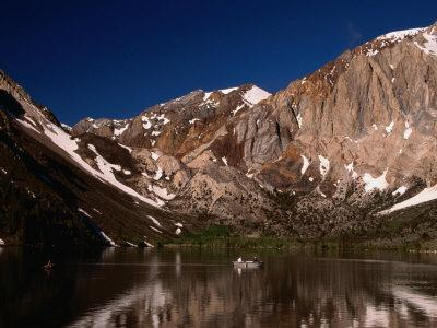 Lone Fisherman on Convict Lake Surrounded by Mountains, California, USA