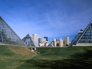 Muttart Conservatory with City Skyline in Distance, Edmonton, Alberta, Canada by Stephen Saks