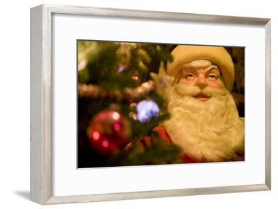 A Christmas Tree Frames the Face of a Large Vintage Santa Claus Figure