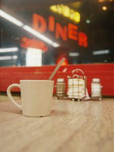 A Coffee Cup and a Diner Sign Spell Late Night Just off Route 95 by Stephen St. John