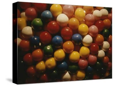A Colorful Close View of Gumballs Behind Glass
