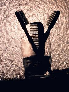 A Comb and Two Toothbrushes on a Bathroom Windowsill by Stephen St^ John