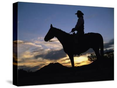 A Cowboy Silhouetted against a Sunset at This Western Movie Location