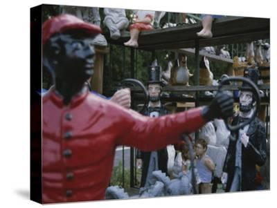 A Curious Mixture of Lawn Ornaments Includes Lincolns and Jockeys