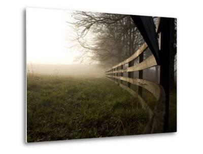 A Fence Disappears into Morning Fog in West Virginia Horse Country
