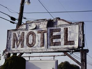 A Neon and Plywood Motel Sign Shows its Age by Stephen St. John