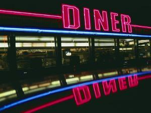 A Neon Diner Sign Relects off a Car Roof by Stephen St. John
