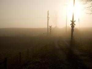 A Railroad Crossing Cloaked in Morning Fog by Stephen St. John