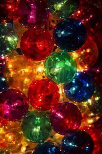 A Stack of Colorful Illuminated Christmas Ornaments by Stephen St. John