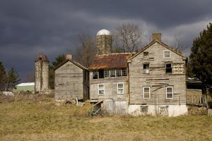 A Storm Approaches Old Abandoned Farm Buildings by Stephen St. John