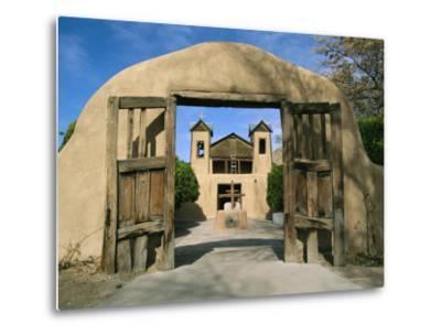 A Vintage Gateway Frames the Sanctuario De Chimayo