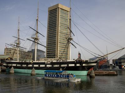 A Water Taxi Passes U.S. Constellation in Baltimore's Inner Harbor