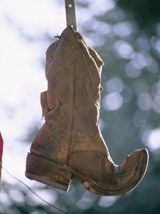 An Old Boot Decorates the Gate of an Alleyway in Chimayo by Stephen St. John