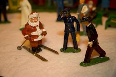 Antique Lead Figures Show Santa Claus Welcomed by a Train Porter