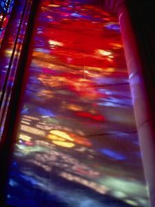 Beautiful Stained-Glass Colors Projected onto a Stone Wall by Stephen St. John