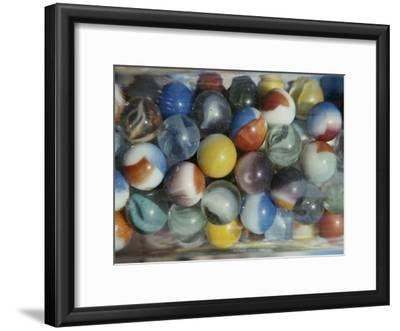 Close View of Colorful Glass Marbles in a Jar