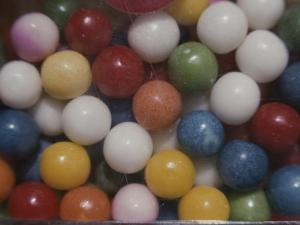 Close View of Colorful Gumballs in a Vending Machine by Stephen St. John