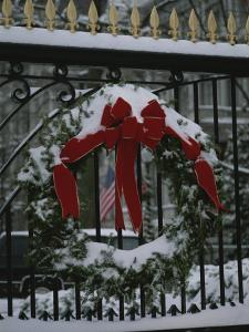 Fresh Snow Covers a Christmas Wreath on the White House Gate by Stephen St^ John