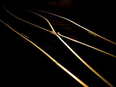 Golden Evening Sunlight Reflects Off Railroad Tracks