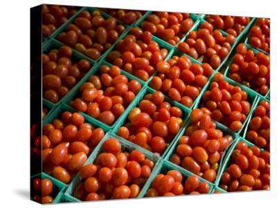 Little Crates of Grape Tomatoes Brighten a Roadside Stand