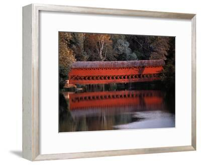 Morning Light Reflects Red Covered Bridge in River