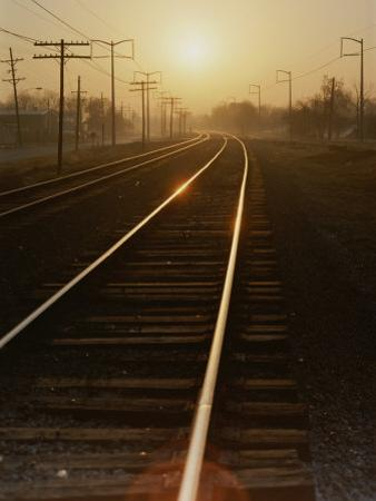 Morning Sun Shines on Railroad Tracks by Stephen St^ John
