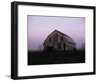 Pink Dawn Mist Around a Weather-Beaten Barn