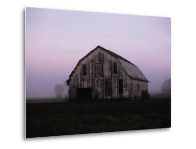 Pink Dawn Mist Around a Weather-Beaten Barn
