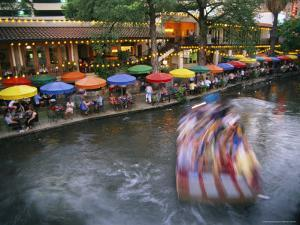 The Blur of a Passing Tourist Boat Along the Colorful Riverwalk by Stephen St. John