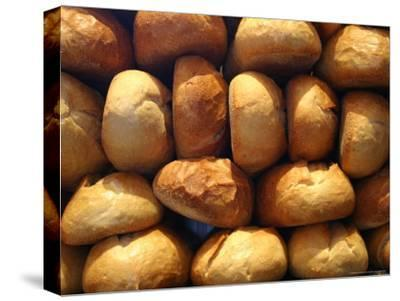 Wall of Fresh-Baked Loaves of Bread Awaits Buyers at the Bakery