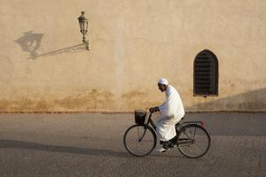 Muslim Man Dressed in White on Bicycle in Old Quarter, Medina, Marrakech, Morocco by Stephen Studd