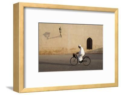 Muslim Man Dressed in White on Bicycle in Old Quarter, Medina, Marrakech, Morocco