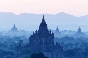 Temples and Pagodas in Early Morning Mist at Dawn, Bagan (Pagan), Myanmar (Burma) by Stephen Studd