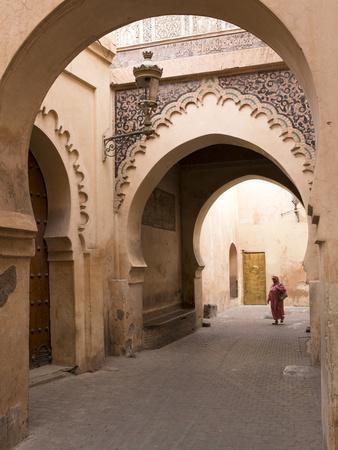 Woman in Traditional Dress Walking in Narrow Side Streets, Old Quarter, Medina, Marrakesh, Morocco
