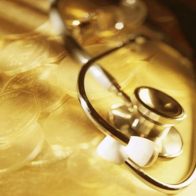 Stethoscope Lying over Gold Coins--Photographic Print
