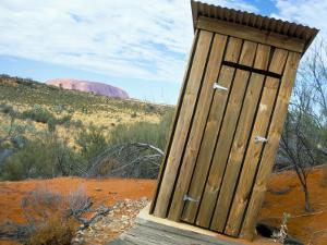 Outback Dunny and Uluru (Ayers Rock), Uluru-Kata Tjuta National Park, Northern Territory, Australia by Steve & Ann Toon