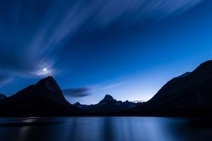 Midnight Over Glacier National Park by Steve Gadomski