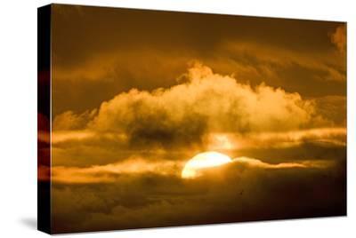 Sun Rising Through the Clouds at Dawn, ANWR, Alaska, USA