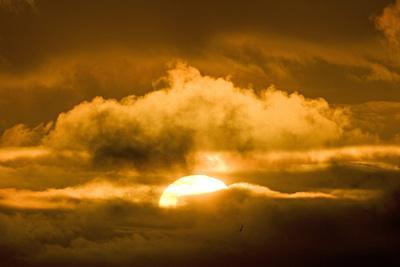 Sun Rising Through the Clouds at Dawn, ANWR, Alaska, USA