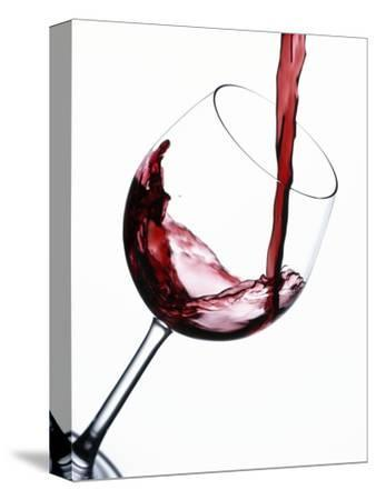 Pouring Red Wine into Wine Glass