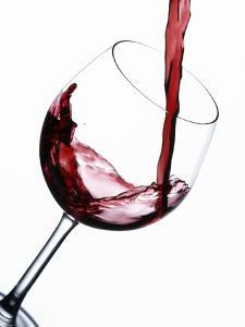 Pouring Red Wine into Wine Glass by Steve Lupton