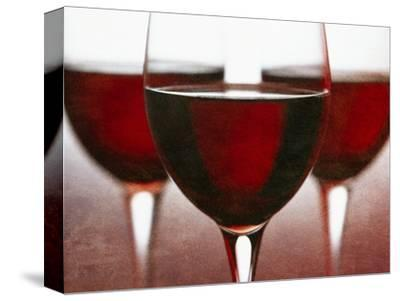 Three Stemmed Glasses of Red Wine
