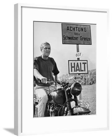 Steve McQueen in a Scene from the Great Escape on Motorcycle-Movie Star News-Framed Art Print