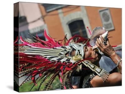 A Conchero Aztec Dancer Elebrates Toxcatl, Dedicated to the Sun