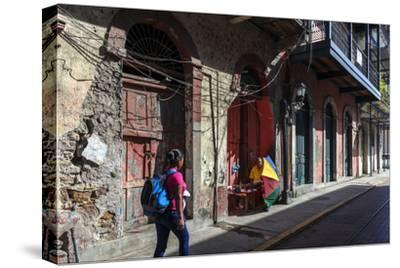 A Tourist Walks Through Panama City's Historic Quarter, known as the Casco Viejo or 'Old Shell'